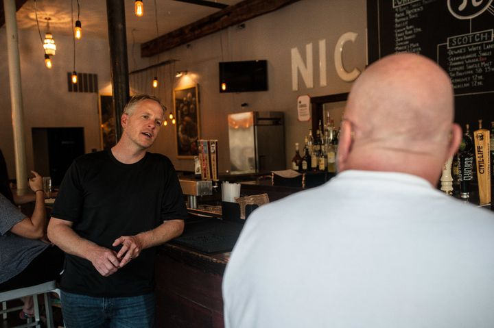 Chris Sommers, owner of Pi Pizzeria, talks to supportive customers in his Central West End location in St. Louis on