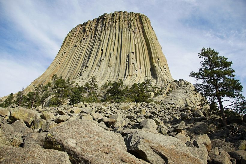 Devils Tower seen from the base. The many rocks and boulders, some house sized, form deep crevasses in which rattlesnakes and