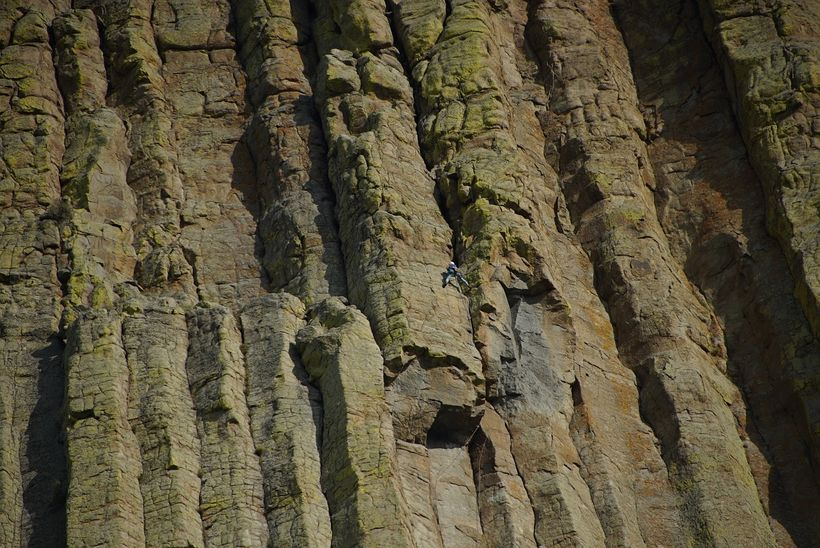 The columnar lava forming the Tower is called Phonolite Porphyry which is a relatively rare type of lava. Note the CLIMBER ju