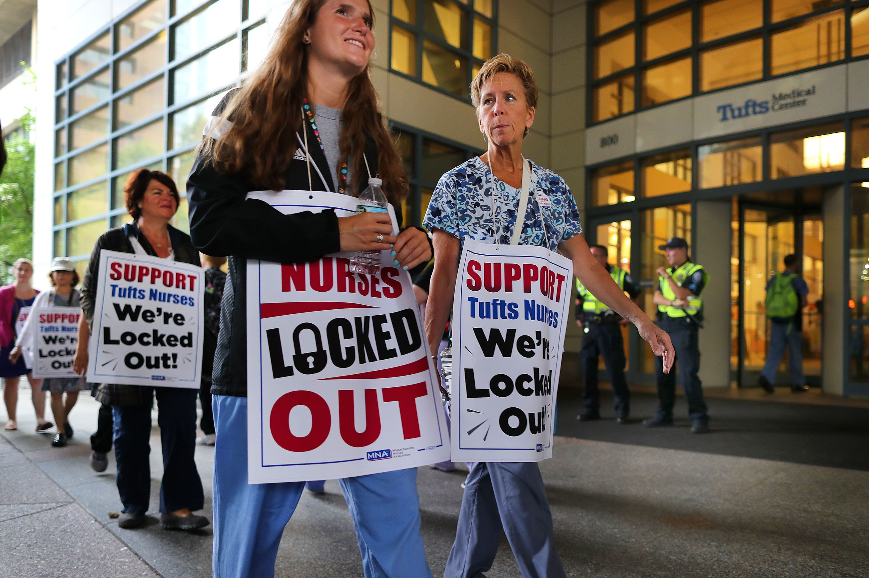 BOSTON, MA - JULY 13: Tufts Medical Center nurses continue to picket after being locked out of their jobs at the hospital in Boston following a 24-hour strike on Jul. 13, 2017. More than 100 members of the striking Massachusetts Nurses Association made a symbolic effort to return to work at the Tufts Medical Center, but they were rebuffed by security as the first nurses strike against a Boston hospital since 1986 turned into a lockout expected to last into Monday. (Photo by John Tlumacki/The Boston Globe via Getty Images)