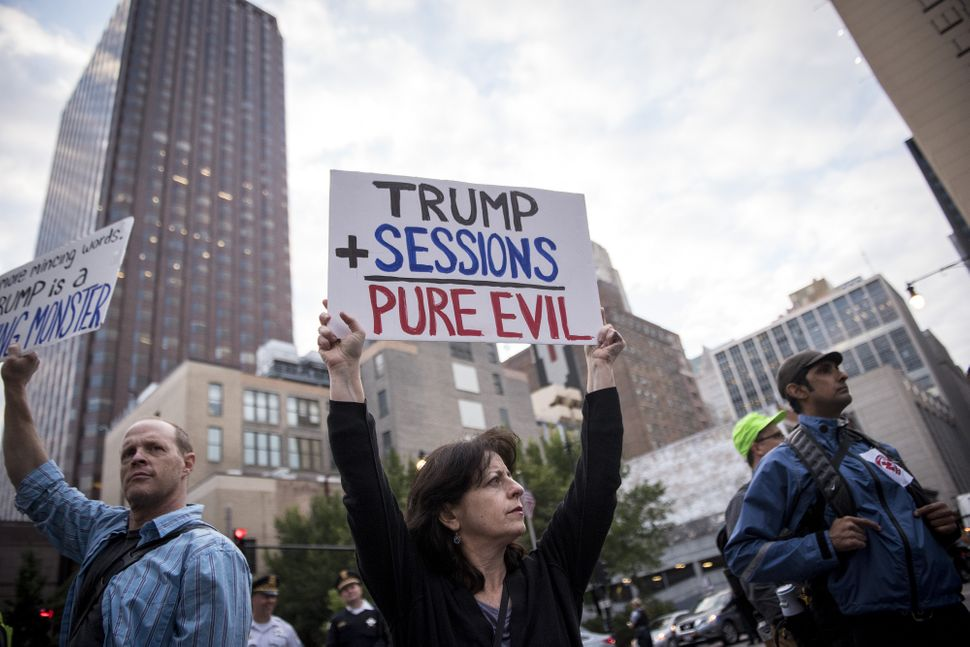 Demonstrators in front of the U.S. Immigration and Customs Enforcement headquarters while protesting the end of the Deferred