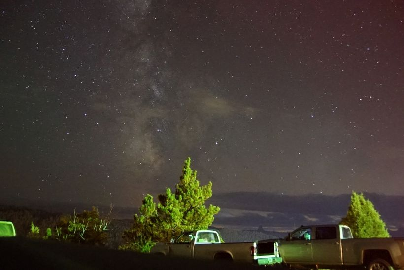 Milky Way with some cloudy interlopers inHulett. Note that Devil's Tower, 9 miles away is visible in the distance just above
