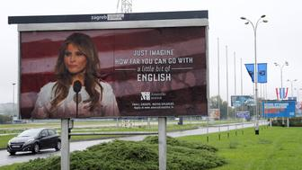 Cars drive near a billboard advertising a language school with the image of U.S. first lady Melania Trump in Zagreb, Croatia, September 17, 2017. REUTERS/Antonio Bronic NO RESALES. NO ARCHIVES - RC11C38371B0