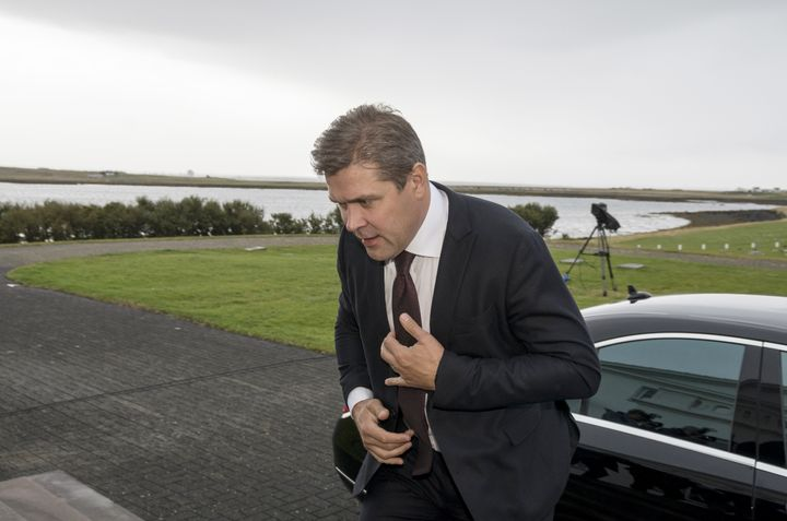Prime Minister Bjarni Benediktsson arrives at the presidential residence in Bessastadir, Iceland, after his government c