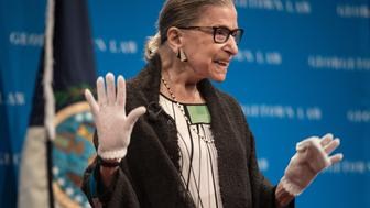 US Supreme Court Justice Ruth Bader Ginsburg acknowledges applause as she  arrives to speak to Georgetown University law students in Washington, DC on September 20, 2017.  / AFP PHOTO / NICHOLAS KAMM        (Photo credit should read NICHOLAS KAMM/AFP/Getty Images)