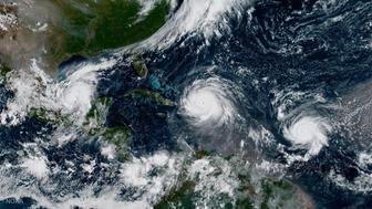 CARIBBEAN SEA - SEPTEMBER 7: In this NOAA handout image, NOAA's GOES satellite shows Hurricane Katia (L) Hurricane Irma (C) and Hurricane Jose (R) on September 7, 2017 in the Atlantic Ocean. South Florida is bracing for the major storm surge set to make landfall this weekend. (Photo by NOAA GOES Project via Getty Images)