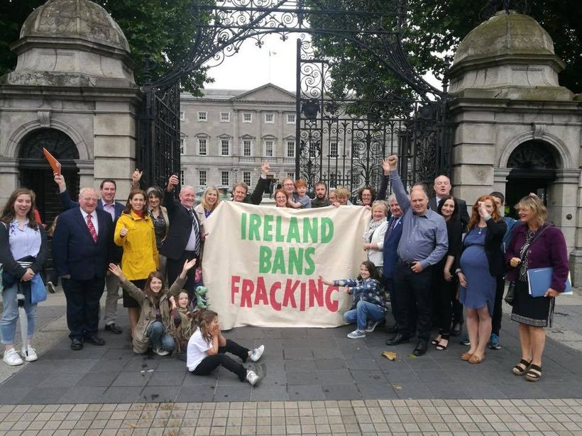 Campaigners celebrate Ireland's legislative ban on fracking outside Government buildings, June 2017