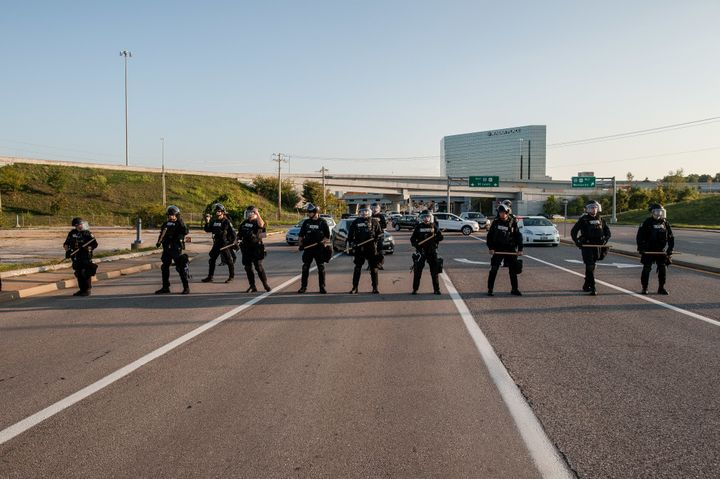Riot police block Brentwood Boulevard by the St. Louis Galleria in Clayton, Missouri, as protesters attempt to march down the