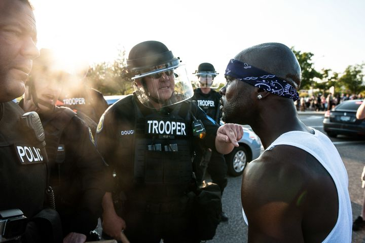 Riot police keep protesters from marching down Brentwood Boulevardin Clayton, Missouri, on Wednesday.
