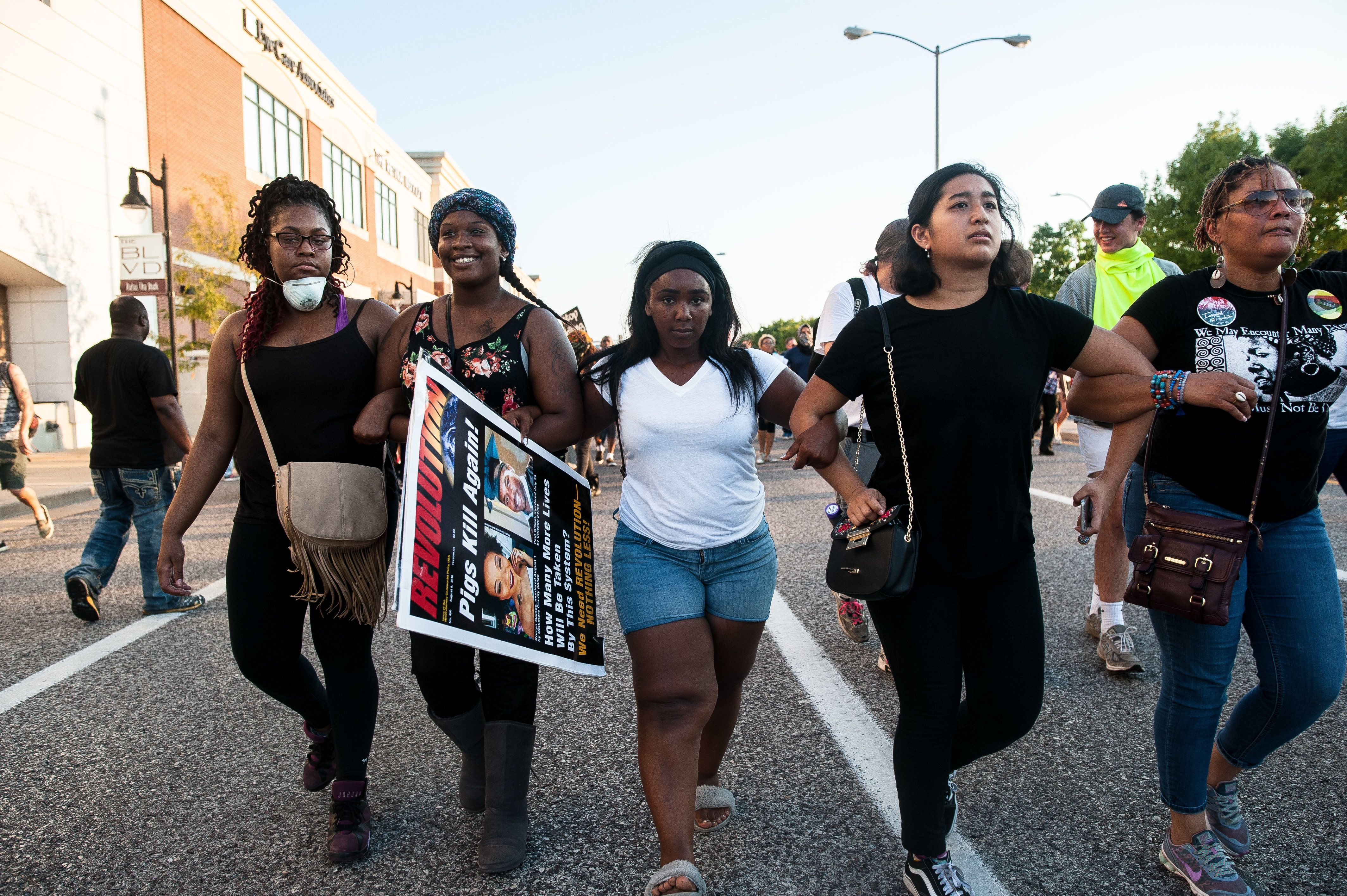 Protesters attempt to retake ground on Brentwood Blvd. after flanking around the police line, looking for a route to the highway.