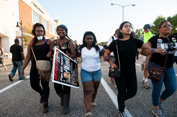 Protesters attempt to retake ground on Brentwood Boulevard in St. Louis after flanking the police line to find a route to the