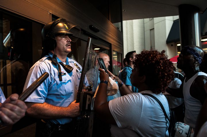 Riot police guard the entrance to the St. Louis Galleria, where protesters gathered on Wednesday.