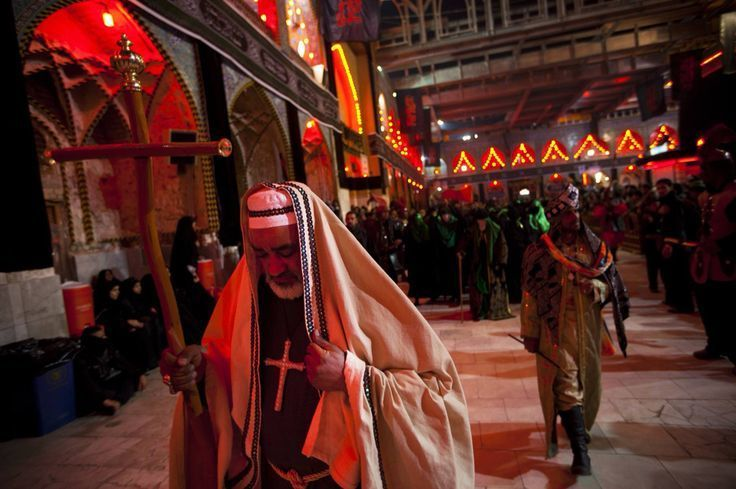A Christian Archbishop from Iraq enters the Shrine of Imam Hussain on the anniversary of his martyrdom.