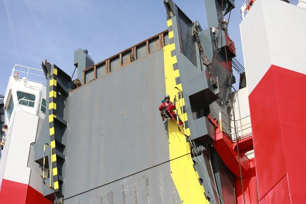Activists are hanging from the ship's unloading