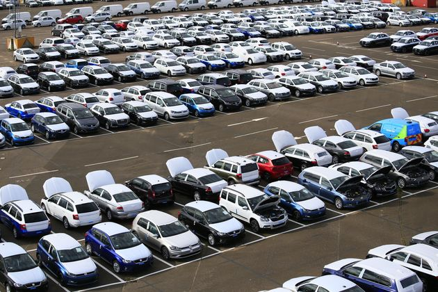 Greenpeace volunteers are attempting to immobilise VW cars at a vehicle park in Sheerness,