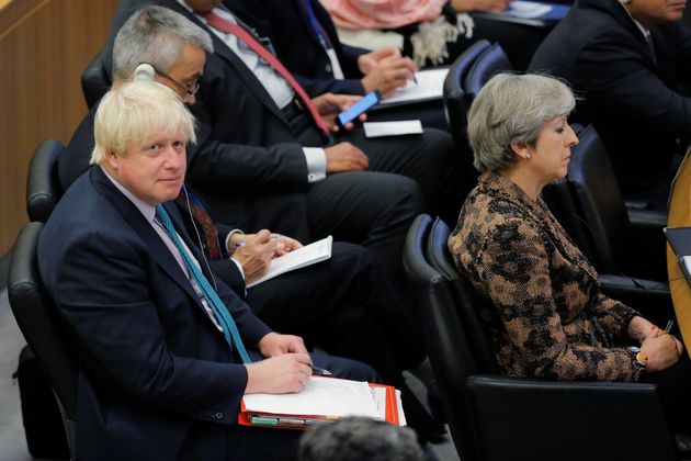 Theresa May sits in front Johnson during a meeting to discuss the current situation in Libya during the...