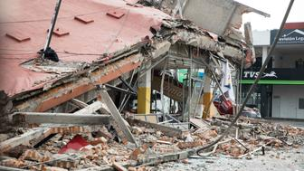 MEXICO CITY, MEXICO - SEPTEMBER 20: A collapsed market is seen at south of Mexico City, one day after the magnitude 7.1 earthquake jolted central Mexico damaging buildings, knocking out power and causing alarm throughout the capital on September 20, 2017 in Mexico City, Mexico. The earthquake comes 32 years after a magnitude-8.0 earthquake hit on September 19, 1985. (Photo by Christian Palma/Getty Images)