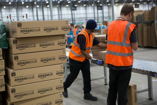 Staff at Amazon in Rugeley load boxes and packages, pictured in