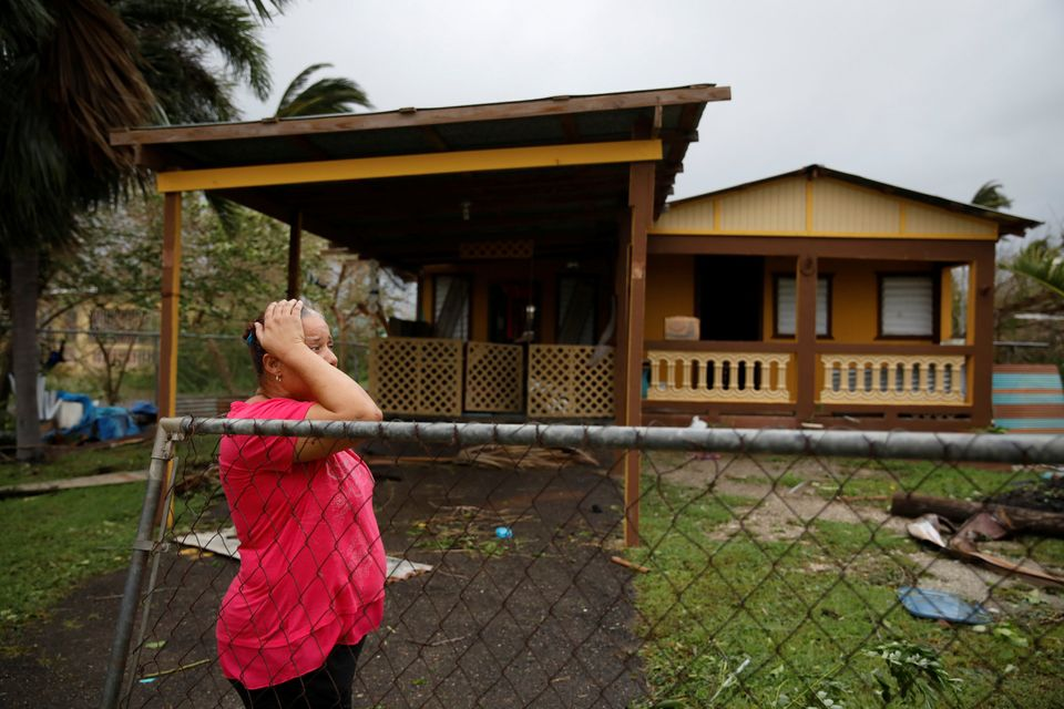 A woman reacts while looking at the damage to her house after the area was hit by Hurricane Maria in Guayama, Puerto Rico.&nb
