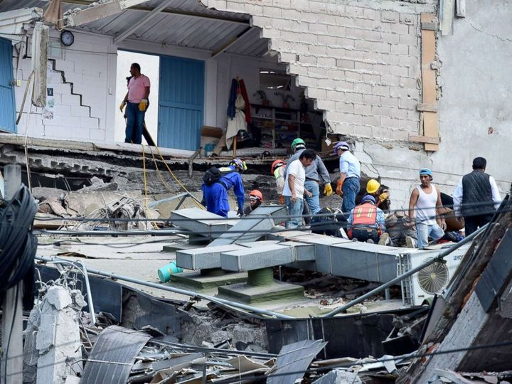 People look for possible victims after walls collapsed during the earthquake in Mexico City