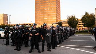 Police officers in riot gear stand near the St Louis Galleria mall on Wednesday night
