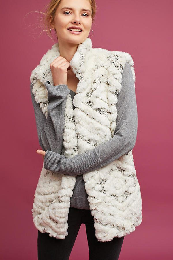 "Just look at this <a href=""https://www.anthropologie.com/shop/basia-faux-fur-vest?category=jackets-blazers&color=010"" tar"