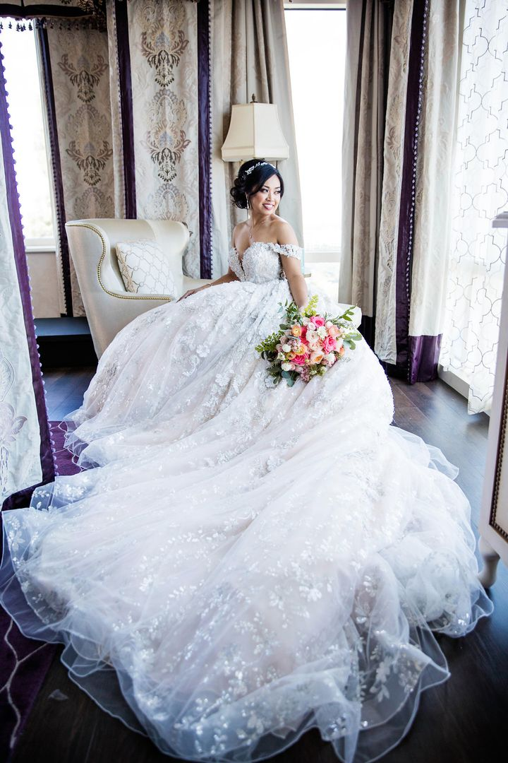 "The bride wore a <a href=""http://www.ysamakino.com/"" target=""_blank"">Ysa Makino</a> gown on her wedding day."