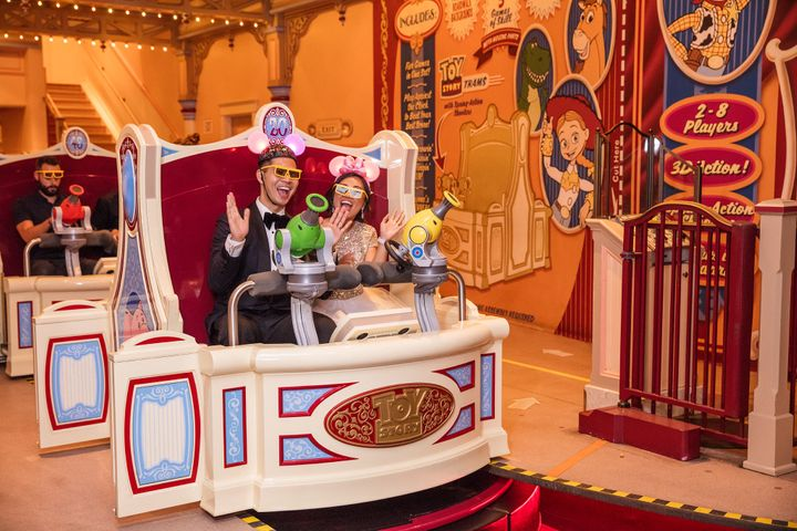 After the reception, the newlyweds enjoyed the Toy Story Mania ride.