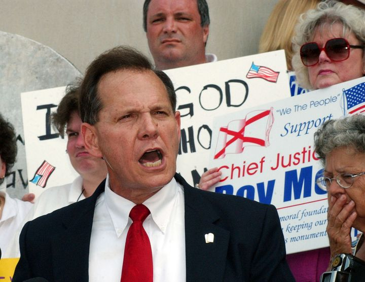 Then-Alabama chief justice Roy Moore speaks outside the state judicial building in Montgomery on Aug. 25, 2003.