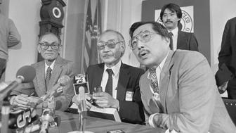 (Original Caption) San Francisco: The government misled the U.S. Supreme Court in three landmark cases which challenged the evacuation of 120,000 Japanese-Americans to internment camps during World War II, the Asian Law Caucus said. Petitions will be filed in U.S. District Courts asking that the cases of three Japanese-American men be re-opened. Shown at press conference here are Fred Korematsu, (left) whose petition will be filed in San Francisco, Minoru Yasui, center, filing in Portland, Ore. and Gordon Hirabayashi, right, filing in Seattle.