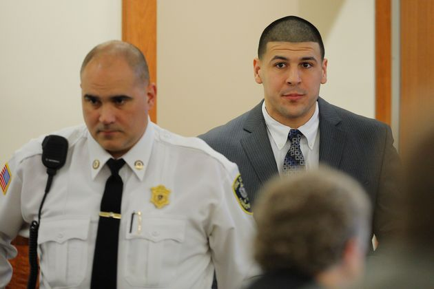Former New England Patriots football player Aaron Hernandez arrives in the courtroom at Bristol County...
