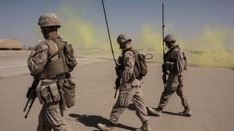 CAMP SHORAB, AFGHANISTAN - SEPTEMBER 10:  Members of the United States Marine Corp Task Force South West walk across a runway after marking a location for an airdrop of cargo on September 10, 2017 at Camp Shorab in Helmand Province, Afghanistan. About 300 marines are currently deployed in Helmand Province in a train, advise, and assist role supporting local Afghan security forces. Currently the United States has about 11,000 troops in the deployed in Afghanistan, with a reported 4,000 more expected to arrive in the coming weeks. Last month, President Donald Trump announced his plan for Afghanistan which called for an increase in troop numbers and a new conditions-based approach to the war, getting rid of a timetable for the withdrawal of American forces in the country. (Photo by Andrew Renneisen/Getty Images)