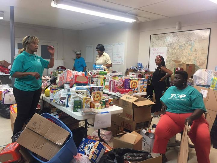 <em>Texas Organizing Project organizers distributing critical resources collected through the Harvey Community Relief Fund. <