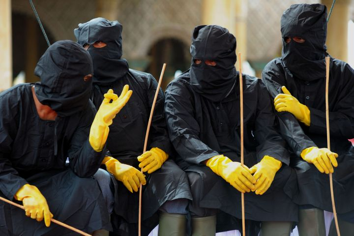 Members of Aceh's so-called Sharia police during a public caning in Meulaboh on Feb.12, 2016. Aceh is the only province