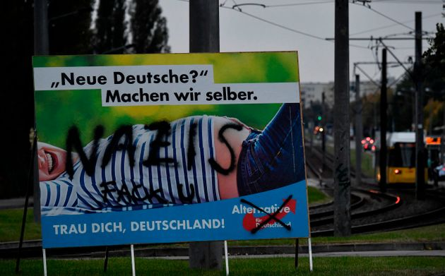 'New Germans? Let's make them ourselves,' says an AfD poster, vandalised with the word