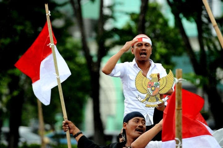 Indonesiandemonstrators call for the police and military to crack down on hard-line Islamist groupslike Islamic D