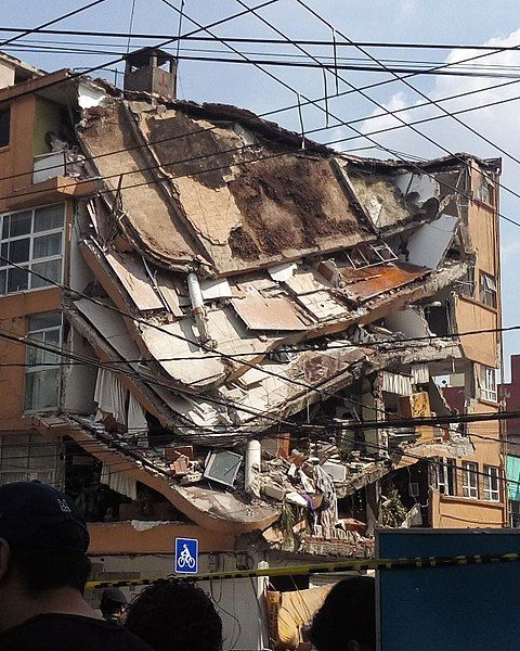 "Partially collapsed building in Mexico City (<a rel=""nofollow"" href=""https://en.wikipedia.org/wiki/File:Ciudad-de-M%C3%A9xico"