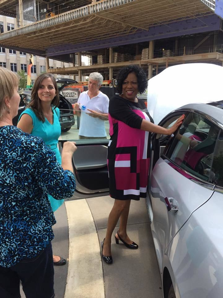 <em>Ann Vail, Executive Director of Louisiana Clean Fuels and Mayor Broome speak for an EV owner at an electric vehicle at t