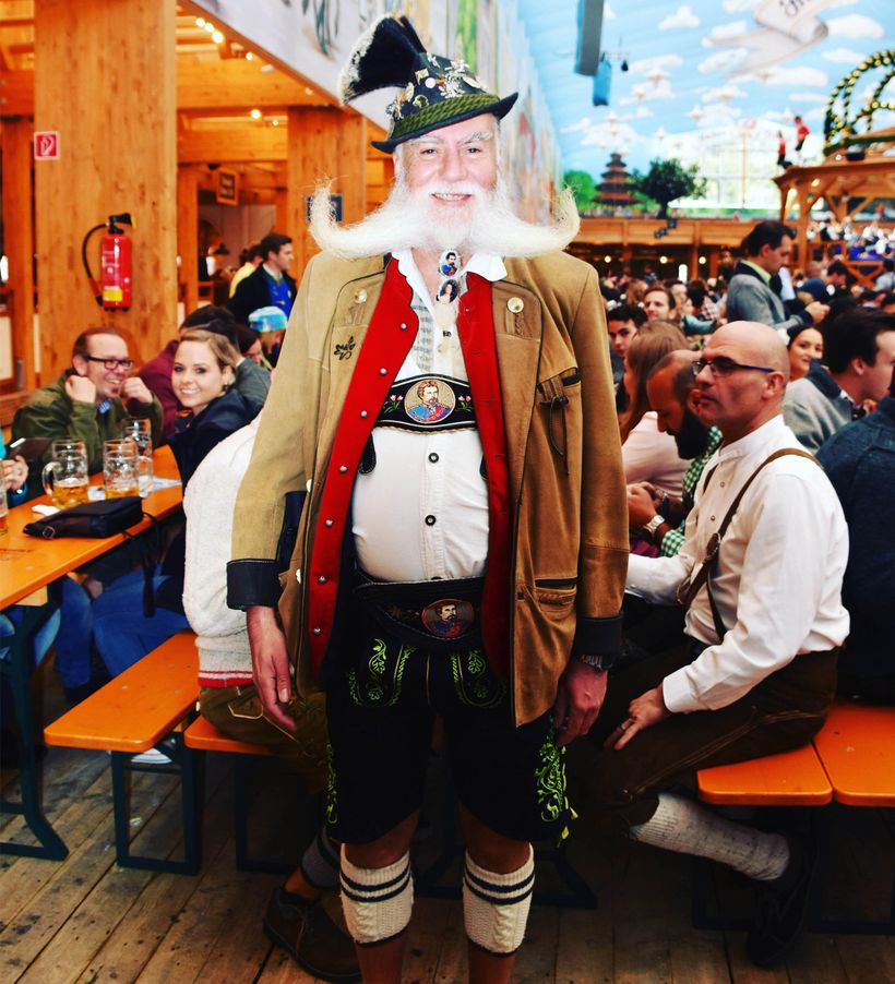 A very dapper man in traditional Bavarian attire.