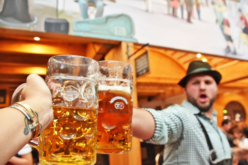 """Ein Prosit"" is one of the most popular songs played at Oktoberfest. Its meaning is ""a toast to cheer and good times"" and the"