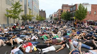 """Protesters stage a """"die-in"""" during a peaceful rally outside the police headquarters after the not guilty verdict in the murder trial of Jason Stockley, a former St. Louis police officer charged with the 2011 shooting of Anthony Lamar Smith, in St. Louis, Missouri, U.S. September 17, 2017. Picture taken September 17, 2017.  REUTERS/Lawrence Bryant     TPX IMAGES OF THE DAY"""