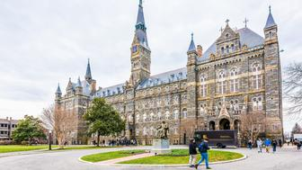 Washington DC: Georgetown University on campus with Healy Hall and people walking out of main building