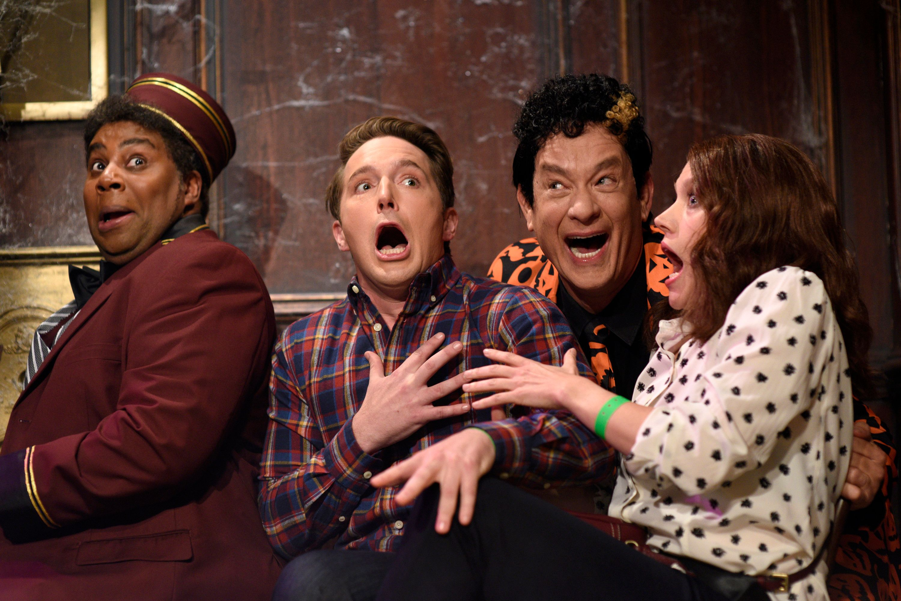 SATURDAY NIGHT LIVE -- 'Tom Hanks' Episode 1708 -- Pictured: (l-r) Kenan Thompson, Beck Bennett, Tom Hanks as David Pumpkins, and Kate McKinnon during the 'Haunted Elevator' sketch on October 22, 2016 -- (Photo by: Will Heath/NBC/NBCU Photo Bank via Getty Images)