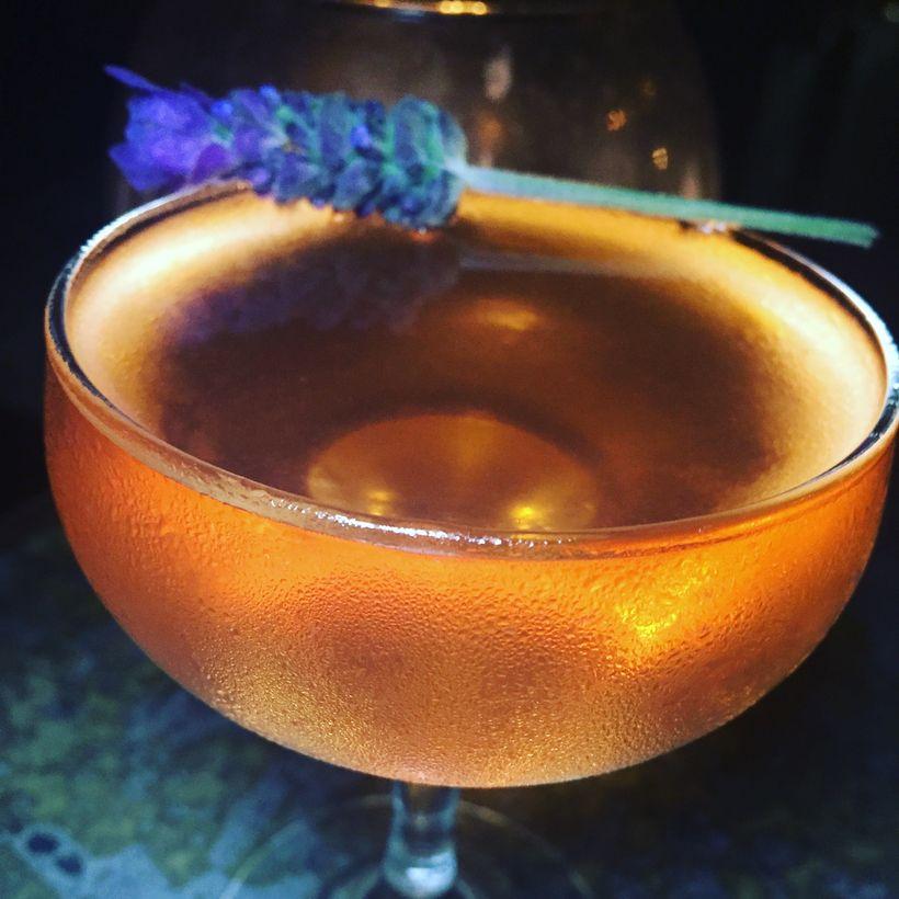 The Reservoir with Botanist Gin, El Silencio mezcal, dry vermouth, Velvet Falernum, strawberry lavender