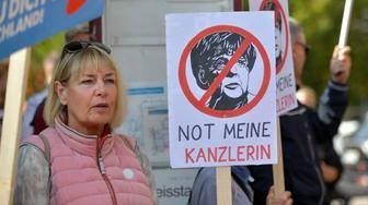 HEPPENHEIM, GERMANY - SEPTEMBER 22: Supporters of the right-wing Alternative for Germany (AfD) political party demonstrate against the German Chancellor and Christian Democrat (CDU) Angela Merkel at a CDU election campaign stop on September 22, 2017 in Heppenheim, Germany. Germans will go to the polls this coming Sunday and Merkel currently has a double-digit lead over her arrivals, though the final election outcome remains uncertain as a significant percentage of voters have so far remained undecided.  (Photo by Thomas Lohnes/Getty Images)