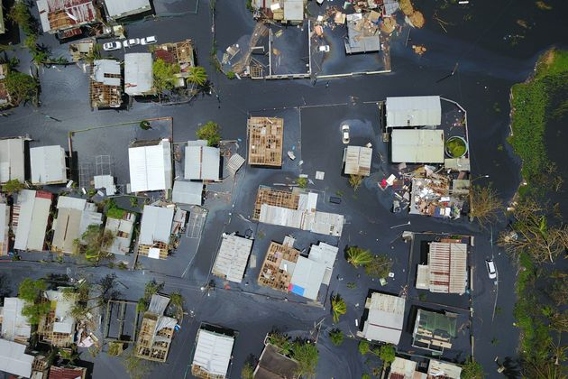 Flooding saturates the neighborhood of Juana Matos in Catano, Puerto Rico, in the aftermath of Hurricane...
