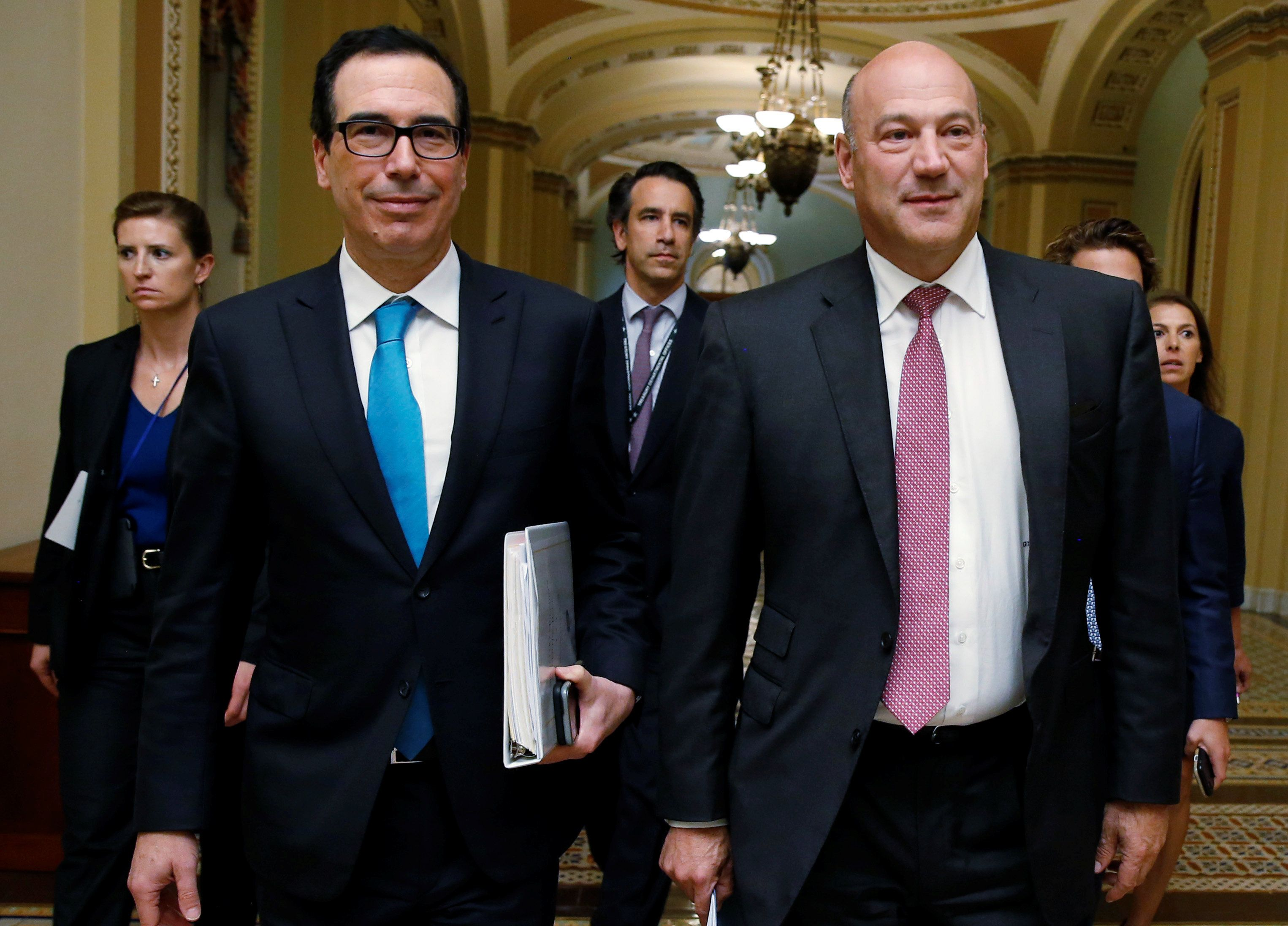 U.S. Secretary of the Treasury Steven Mnuchin and Director of the National Economic Council Gary Cohn walk after meeting with Republican law makers about tax reform on Capitol Hill in Washington, U.S., September 12, 2017. REUTERS/Joshua Roberts