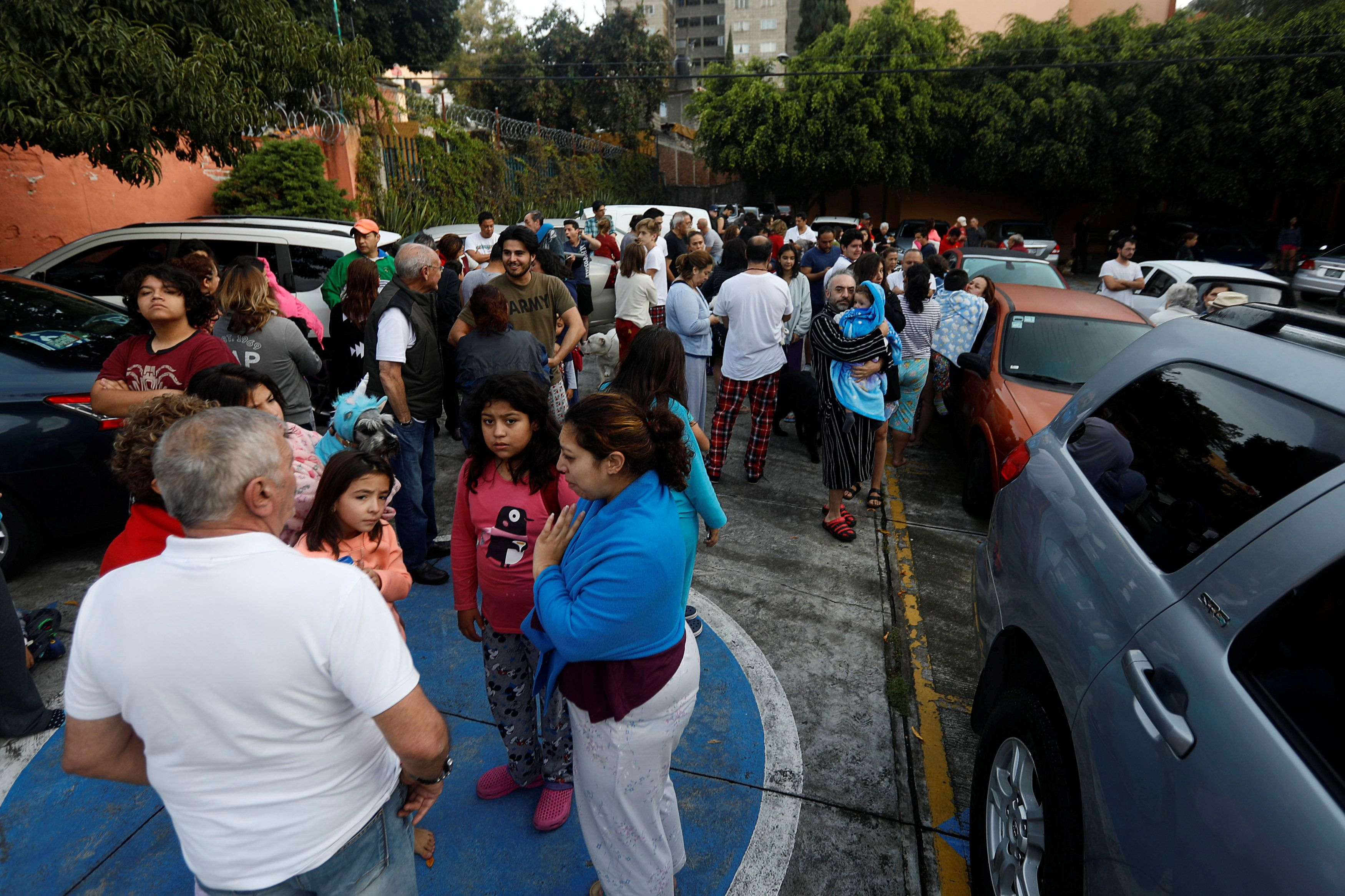 People gather inside a residential area after a tremor was felt in Mexico City, Mexico, on Sept. 23.