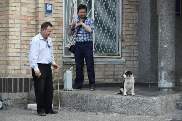 Workers with a stray dogat the Chernobyl nuclear power plant inAugust