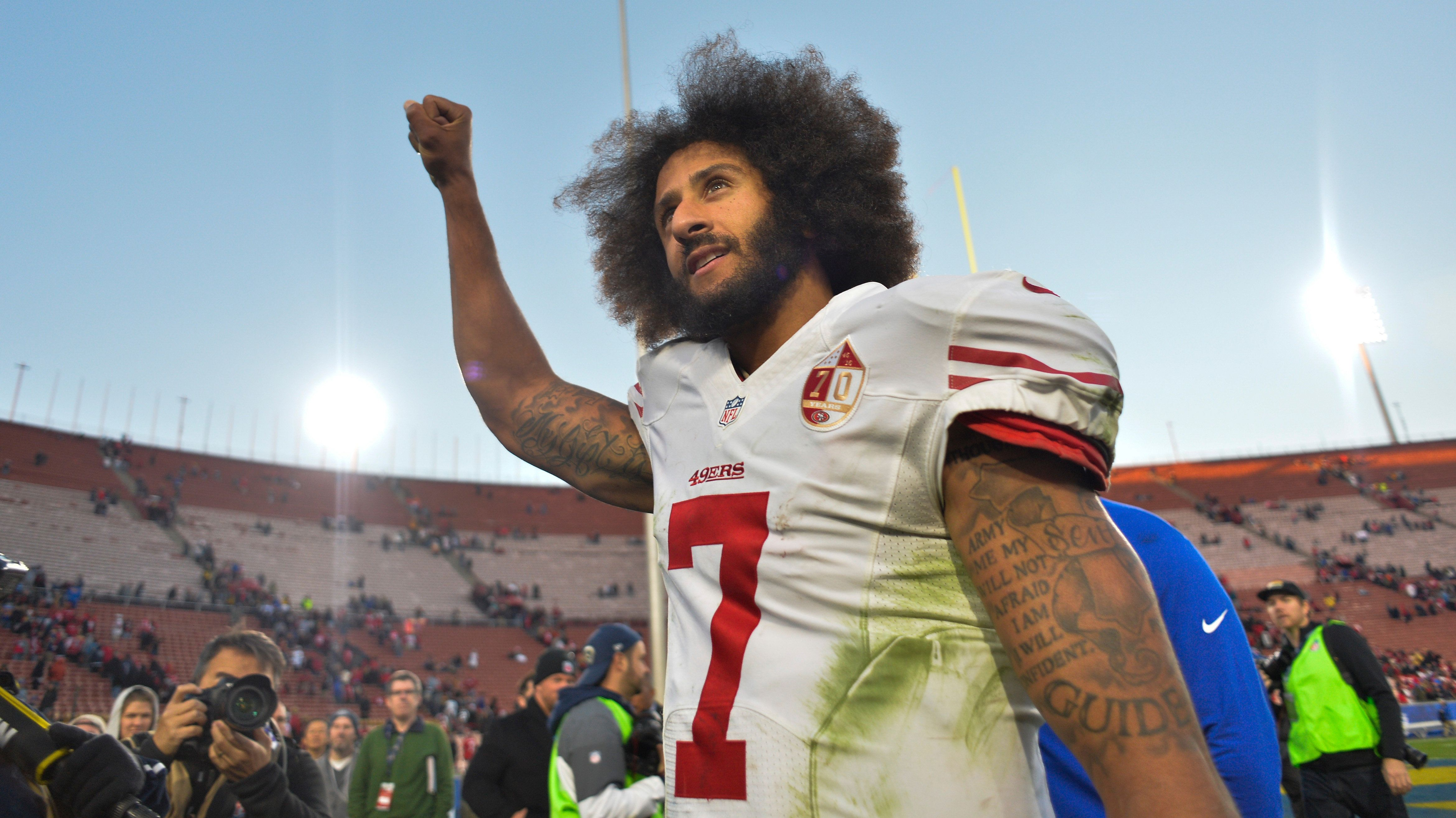 Dec 24, 2016; Los Angeles, CA, USA; San Francisco 49ers quarterback Colin Kaepernick (7) pumps his fist as he acknowledges the cheers from the 49ers' fans after leading his team to a 22-21 come-from-behind win over the Los Angeles Rams at Los Angeles Memorial Coliseum. Mandatory Credit: Robert Hanashiro-USA TODAY Sports